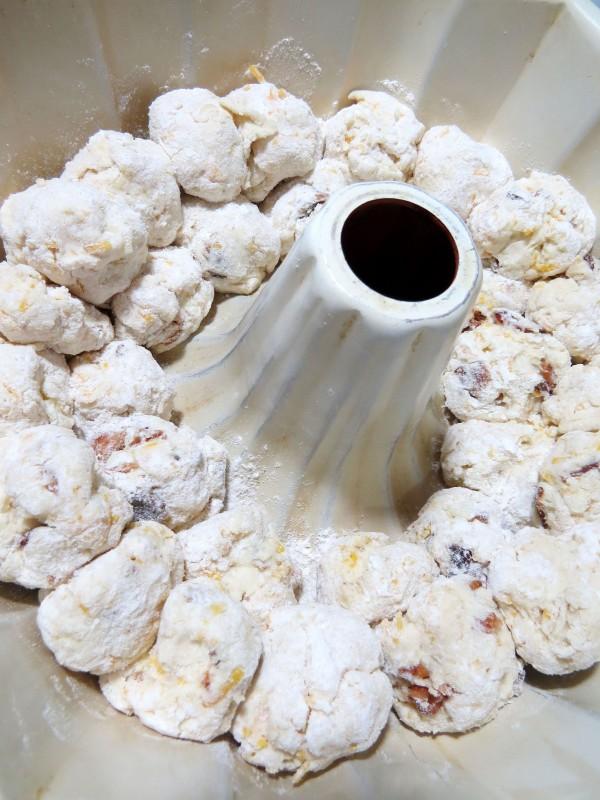 dough balls layerd in bundt pan