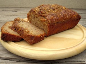 Sliced applesauce walnut bread on wood tray