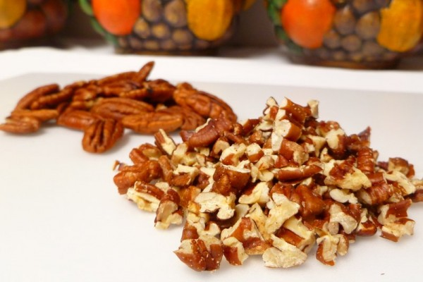 Whole and chopped pecans ready for toasting