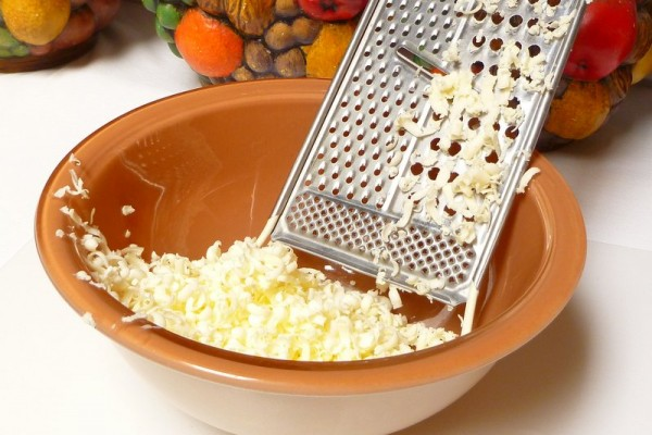 Grating frozen butter into a bowl