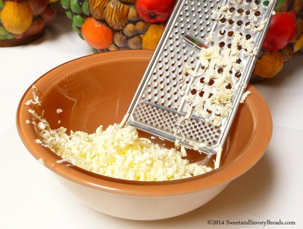 Grating frozen butter into a bowl