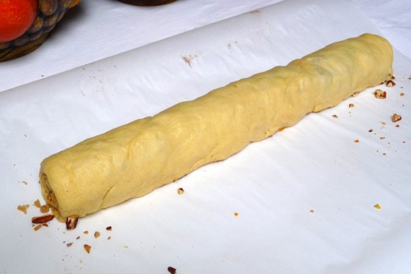Crescent roll dough filled and ready for slicing