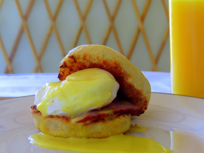 English Muffin Breakfast Sandwich with a poached egg tri-tip and hollandaise.